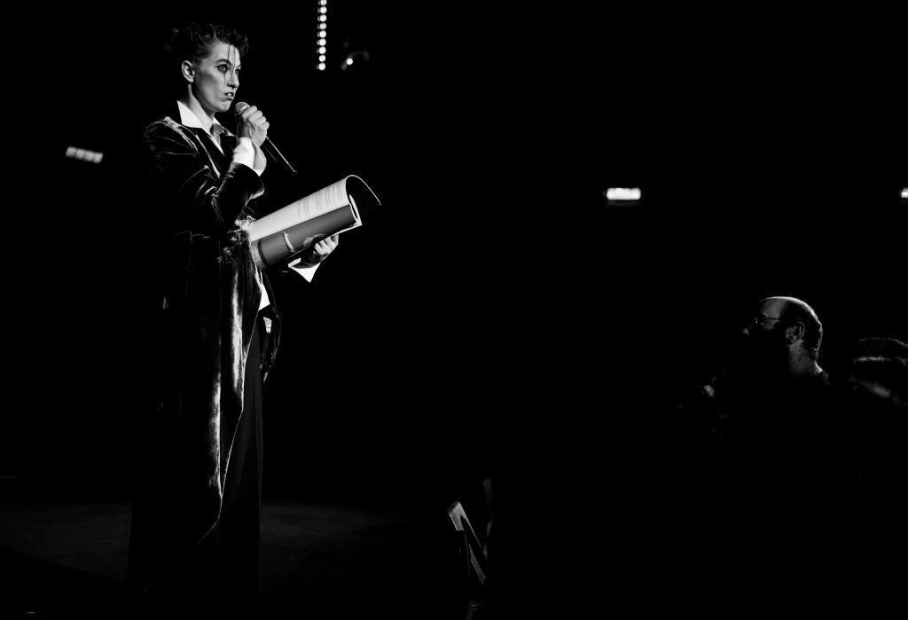 "Performance image of Amanda Palmer reading from the Art Book of ""There will be no Intermission"" - taken at The Union Chapel in London"