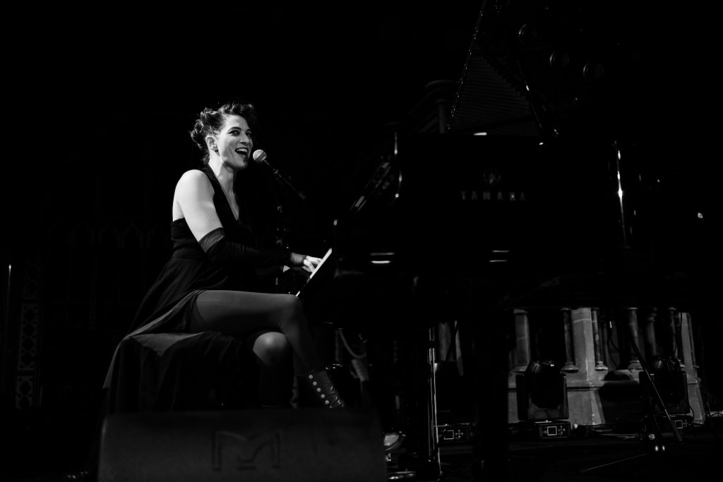 Performance image of Amanda Palmer at a Grand Piano - taken at The Union Chapel in London